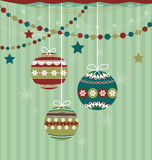 Three Christmas balls on striped background Royalty Free Stock Photos