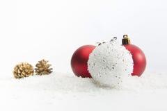 Three Christmas balls on white background Stock Photos