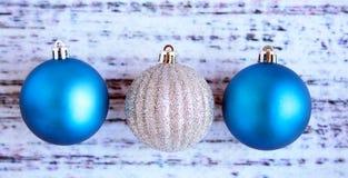 Three Christmas Balls on wood Royalty Free Stock Photos