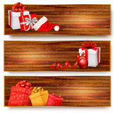 Three christmas banners with gift boxes and santa  Royalty Free Stock Photography