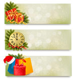 Three christmas banners with gift boxes and snowfl Royalty Free Stock Photos