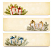 Three christmas banners with gift boxes and snowfl Royalty Free Stock Photography