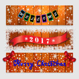 Three Christmas banners with inscriptions of welcome, 2017 and Happy Christmas. Wood texture.  Royalty Free Stock Photo