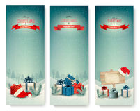 Three Christmas banners with presents. Vector Stock Images