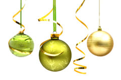 Three christmas baubles. Green and gold hanging Christmas baubles Royalty Free Stock Photos