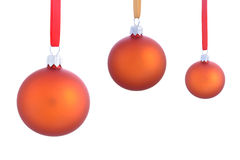 Three christmas baubles isolated on white Royalty Free Stock Photo