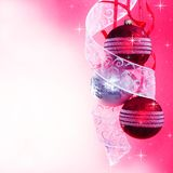 Three Christmas Baubles with Ribbon. On Spotted Background Royalty Free Stock Images