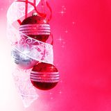 Three Christmas Baubles with Ribbon. On Spotted Background Royalty Free Stock Photography
