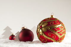 Three Christmas baubles on white background Royalty Free Stock Photography