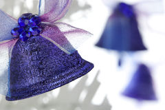 Three Christmas bells. With bows Royalty Free Stock Photos