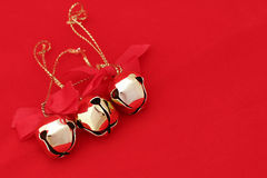 Three Christmas Bells On Red (left) Royalty Free Stock Photography