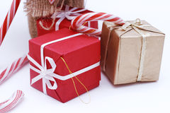 Three christmas boxes. And candy canes Stock Images