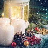Three Christmas burning candles and lantern on dark turquoise background Stock Photos