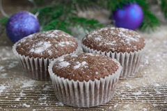 Three Christmas cakes, winter snowbound wooden background, purpl Royalty Free Stock Images