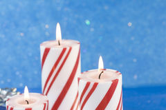 Three Christmas candles Stock Photography