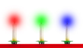 Three Christmas candles Stock Photo