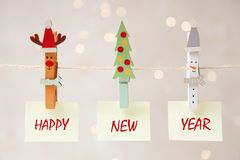 Three Christmas clothespins with note royalty free stock images