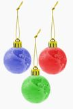Three Christmas colorful globe ornaments Stock Photo