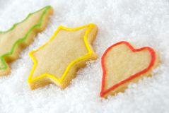 Three christmas cookies. Lying in the snow Royalty Free Stock Photo