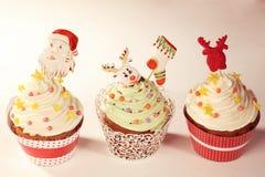 Three Christmas cupcakes Stock Photos