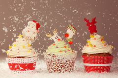 Three Christmas cupcakes Stock Photos