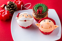 Three Christmas cupcakes  on a plate Royalty Free Stock Photo