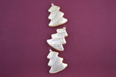 Three Christmas decoration gold firs Stock Photography