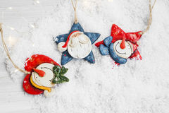 Three Christmas Decoration in the Snow, Santa and Snowman Deco w Royalty Free Stock Images