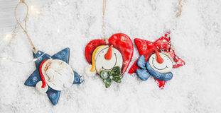 Three Christmas Decoration in the Snow, Santa and Snowman Deco w Royalty Free Stock Image