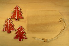 Three Christmas decoration with wooden pricetag Stock Photography