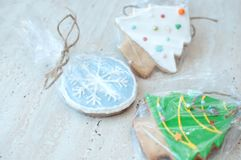 Three Christmas gingerbread cookies in the different shapes close-up. Selective focus, bokeh. Three Christmas gingerbread cookies in the different shapes in a Stock Photo