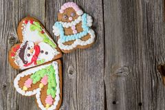 Three Christmas Gingerbread Cookies on Wooden Table on Wooden Table. Christmas Gingerbread Cookies on Wooden Table. Christmas Still Life Photo Royalty Free Stock Photography