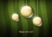 Three christmas  globe. On green background Royalty Free Stock Photography