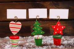 Three christmas greeting card holders on wooden table Royalty Free Stock Photo