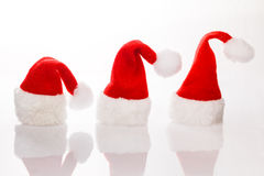 Three Christmas hats Santa row Royalty Free Stock Photography