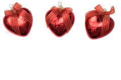 Three christmas heart shaped red ball isolated on white Royalty Free Stock Images