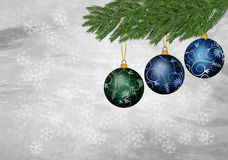 Three christmas ornament on a textured background Royalty Free Stock Photography