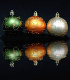 Three christmas ornaments. With a beautiful reflection Royalty Free Stock Images