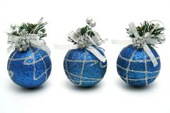Three christmas spheres of dark blue color. With a pattern horizontally Stock Images