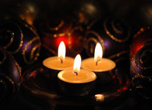 Three Christmas tea lights. Three christmas tea candles with decorations royalty free stock image