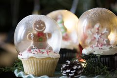 Three Christmas-themed Glass Snow Globes Stock Photos