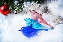 Three christmas toys glass birds Royalty Free Stock Photos
