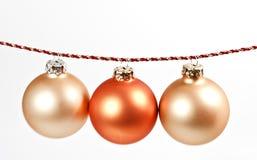 Three christmas tree balls. Three hanging christmas tree balls Stock Photo