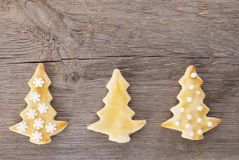 Three christmas tree cookies on wood brackground Royalty Free Stock Photography
