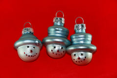 Three Christmas Tree Snowmen. Three Christmas Tree Decoration Snowmen on Red Background Stock Images