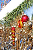 Three Christmas-tree toys on a branch Royalty Free Stock Photos