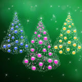 Three Christmas trees with garlands balls Royalty Free Stock Photography