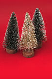 Three christmas trees on red background Stock Photography