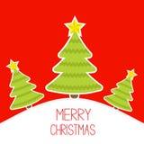 Three Christmas trees a snowy hill.  Merry Christm Stock Photos