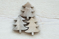 Three Christmas Trees On White Wooden Background Royalty Free Stock Image